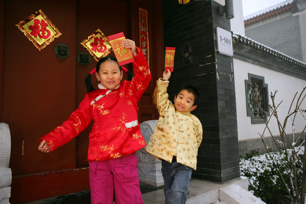 Happy chinese kids receiving gifts