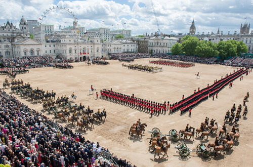 The Queen's Birthday Parade also known as Trooping the Colour, Horse Guards Parade, London, June 2013.  More than a thousand soldiers and horses from the Household Division paraded in front of their Colonel in Chief, Her Majesty The Queen, 15th June 2013, with the immaculate precision, colour and pageantry that marks them as truly World Class.     Later as the last shot of a 41 gun Royal Salute was fired from The Green Park to mark The Queen's Official Birthday, the skies roared with an impressive fly past from the RAF featuring 32 aircraft of 13 different types.  The centuries old tradition of Trooping The Colour has been held on Horse Guards Parade to honour the Sovereign's Birthday almost annually since 1805.  Each year the Five Foot Guards Regiments take it in turns to Troop their Colour in front of the Sovereign.  Colour is the name given to regimental flags of the British Army, and were used as rallying points as long ago as the Kings of Babylon.    In the Middle Ages, each Lord or Baron flew his banner as a sign by which his followers could distinguish him in battle. Colours were last carried into action by the 58th Foot in South Africa in 1881.  Up to that time they participated in all the varying fortunes of their Regiment; were often torn by enemy fire and acquired an almost religious significance.    Even today, uncased Colours are invariably carried by an officer and accompanied by an armed escort.  This year, the Colour being trooped in the presence of Her Majesty The Queen, was that of the 1st Battalion Welsh Guards.  The Welsh Guards have recently returned from operational service in Afghanistan where they worked as part of the Afghan Police Advisory Team assisting the country to achieve self governance. The Field Officer in Brigade Waiting, Lieutenant Colonel Dino Bossi, Welsh Guards, commanded the Parade.