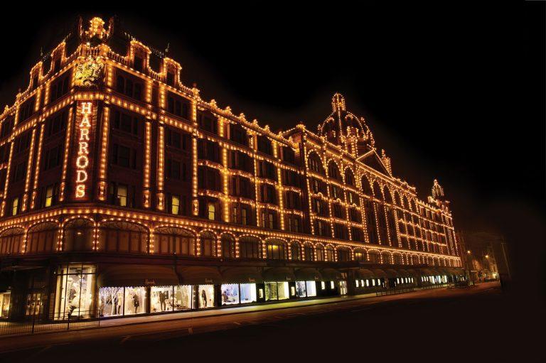 Harrods exterior lighting up at night