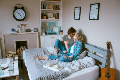 Couple in bed enjoying date night at home