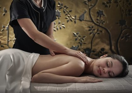 Woman receiving spa massage