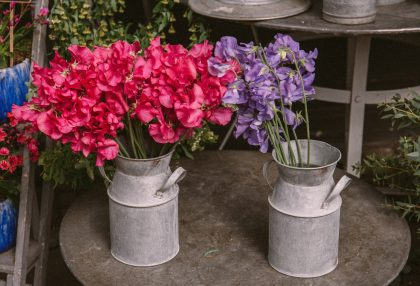 Tin vases filled with flowers