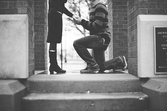 Man Proposing on One Knee to Woman