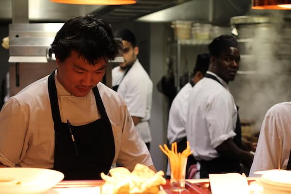 Andrew Wong and his kitchen staff