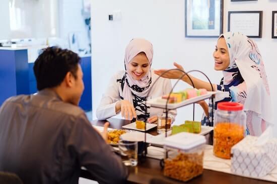 Laughing Women Wearing Hijabs