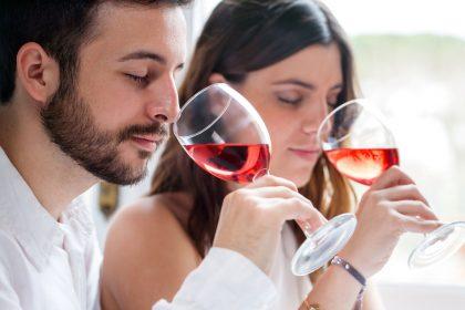 Couple nosing wine in wine tasting experience