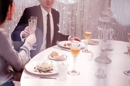 Couple enjoying dinner at Table Lumiere at Alain Ducasse at the Dorchester