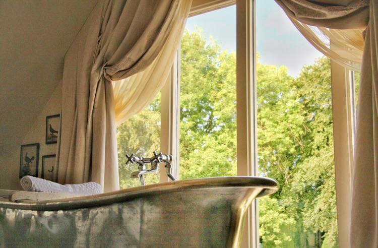 Bathtub with a view at Dormy House Hotel