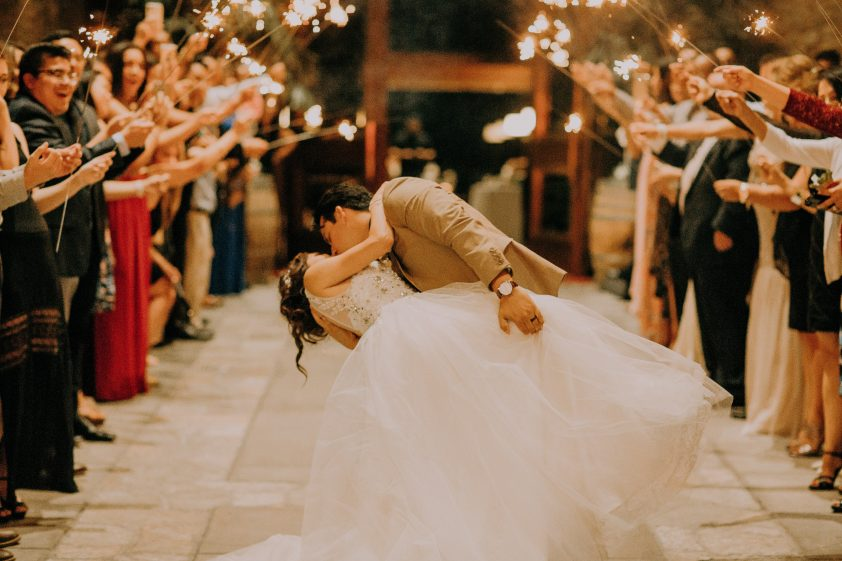Groom and bride dancing at their wedding