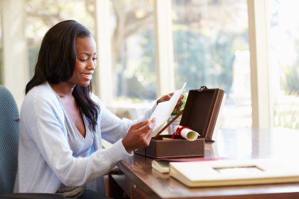 Woman looking at letter in keepsake box