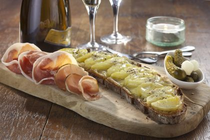 Champagne tasting with artisanal cheese and French charcuterie on wooden board