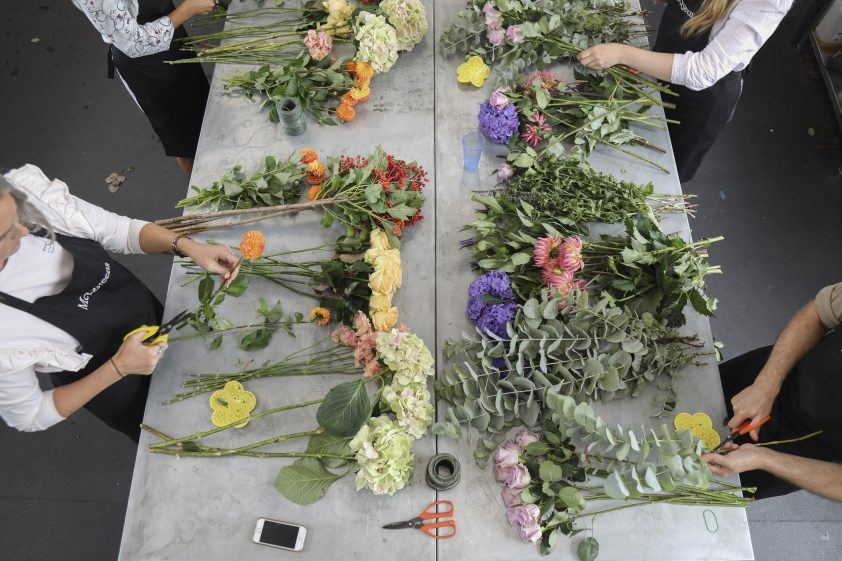 Students learning how to arrange flowers at flower arranging school