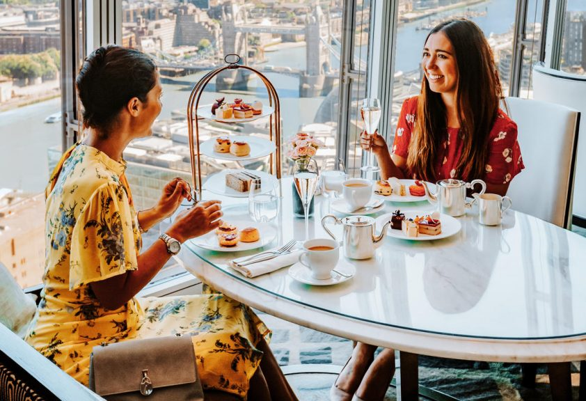 Women enjoying afternoon tea in TING lounge