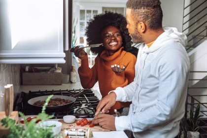 Couple enjoying a cooking class at home