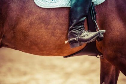 Horserider with foot in iron stirrups
