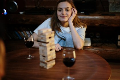 Woman playing a game of Jenga with wooden blocks
