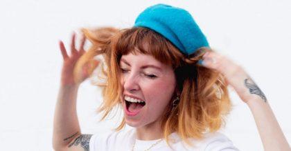 Woman wearing a hat dancing crazy