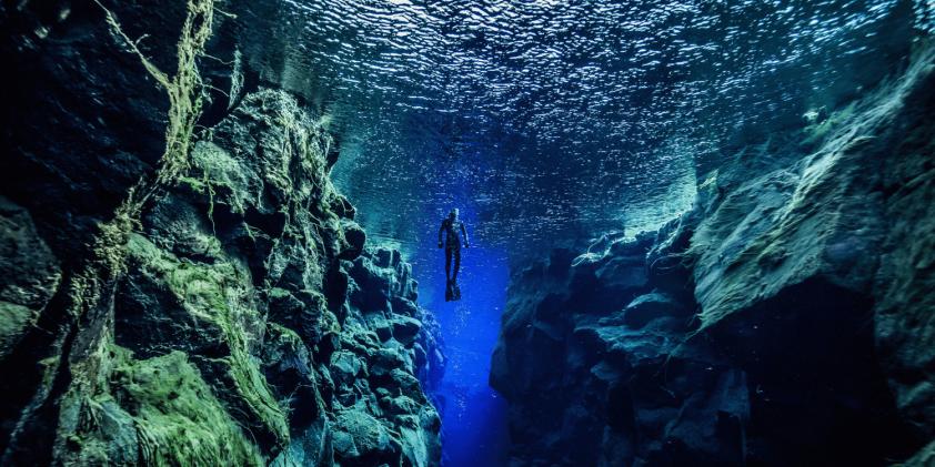Snorkeler between the Iceland Silfra fissure