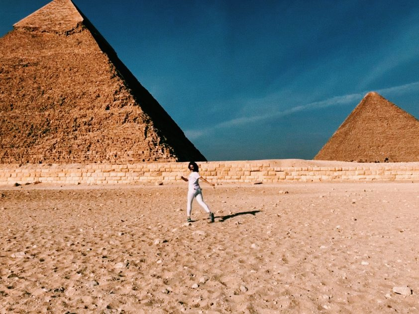woman at the pyramids in Egypt