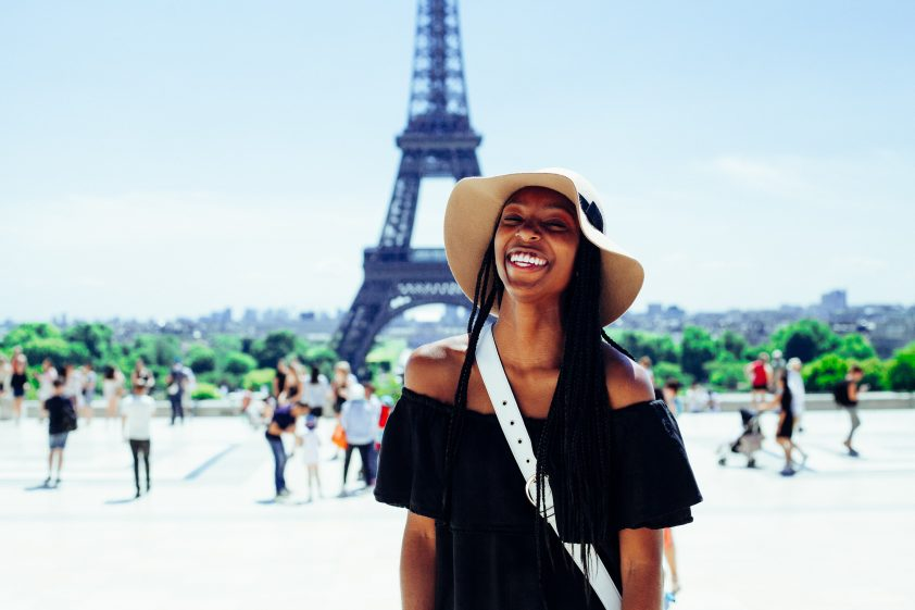 Smiling woman at the Eiffel Tower in Paris