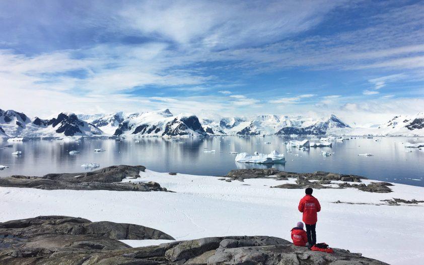 Couple enjoying the view in Antarctica