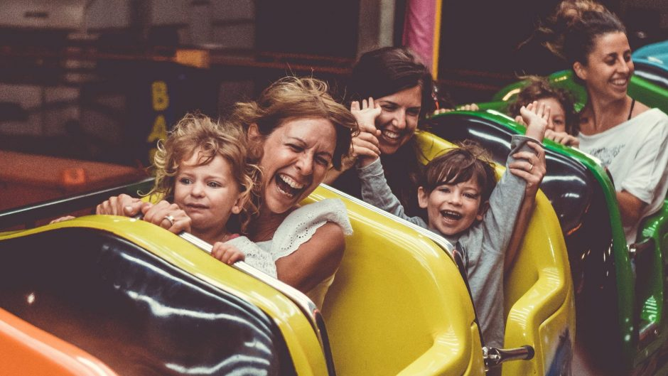 Family having fun fear on rollercoaster