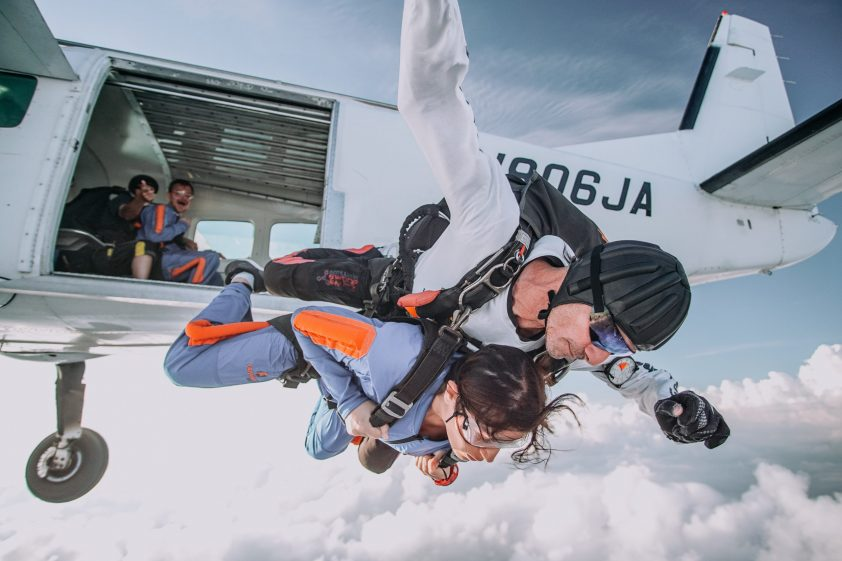Skydivers jumping out of an aeroplane