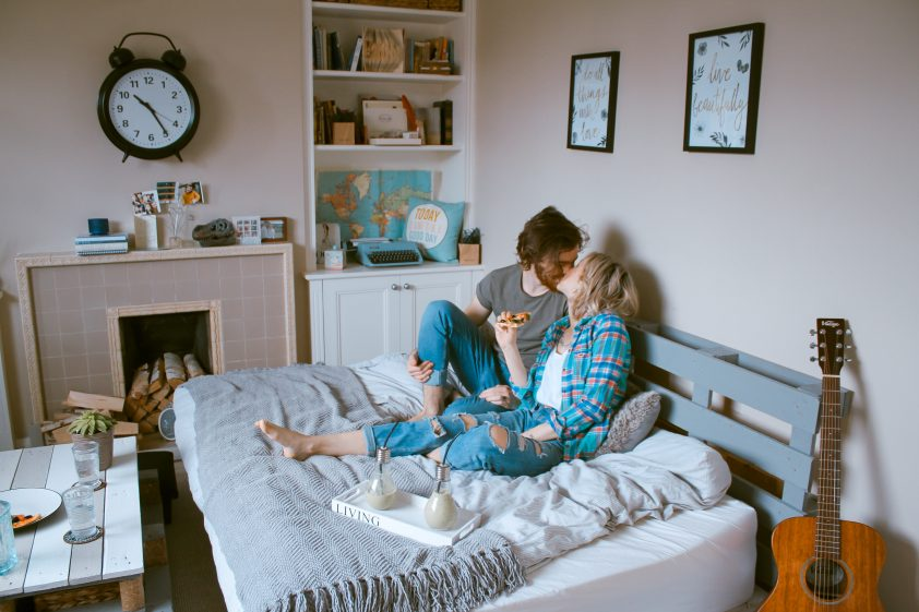 Man and woman cosy in bed