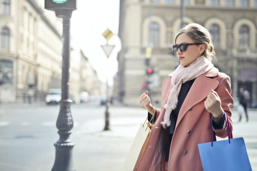 Woman holding shopping bags after shopping spree