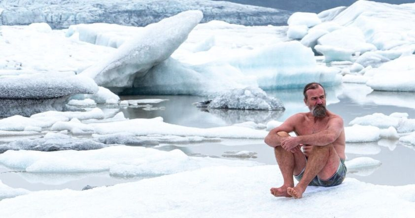 Wim Hof sitting on iceberg
