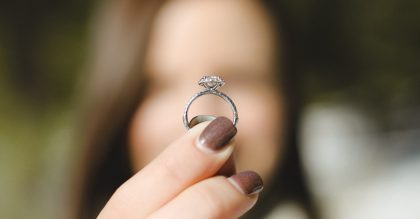 Bride holds diamond wedding ring