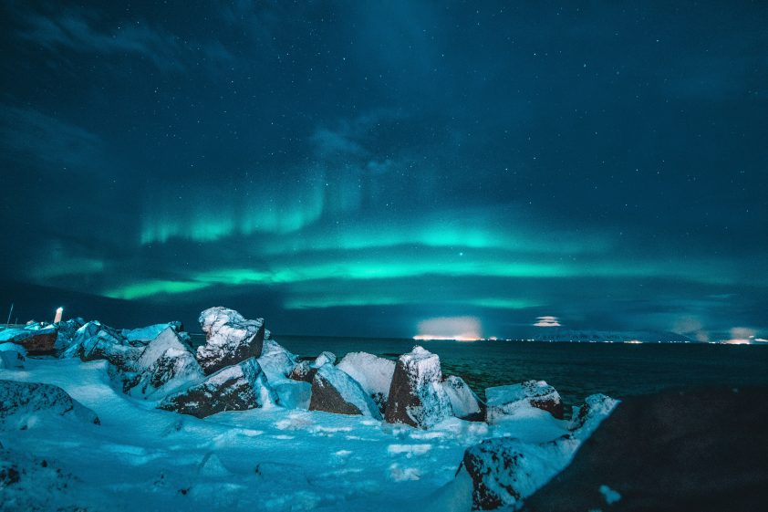 The northern lights light up the sky in the Arctic circle