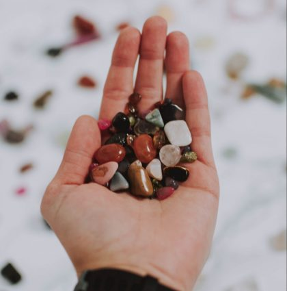 Person holding assorted pebbles
