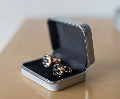 Gold shirt cufflinks in a silver box