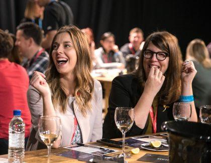 Women having fun wine tasting with chocolate pairing