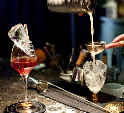Freshly made cocktail being poured