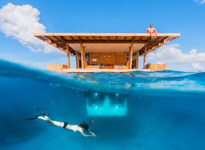 Swimmer beneath the Manta Resort in Tanzania