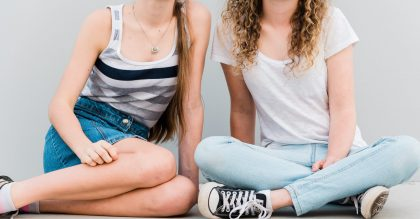 Two teenage girls sitting in different seated positions