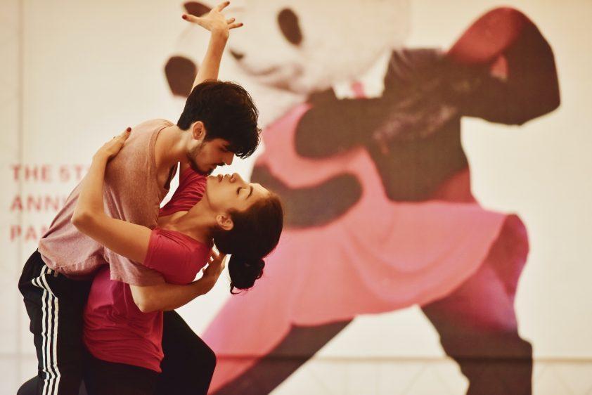 Man and woman salsa dancing