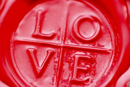 Wax seal with love stamped in it