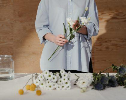Woman holding white chrysanthemums