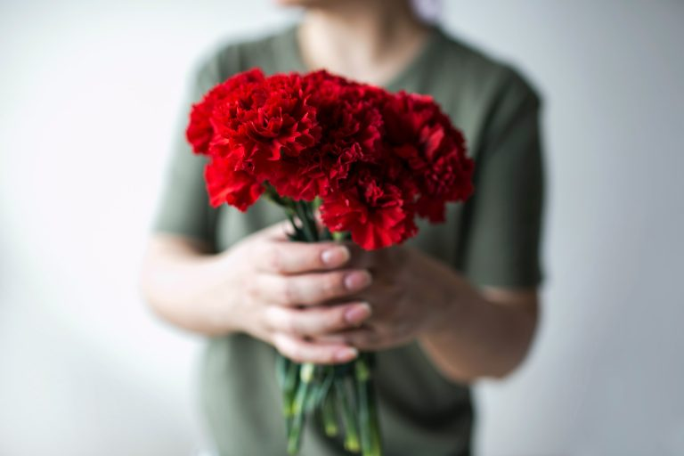 Bouquet of red carnations for 1st wedding anniversary