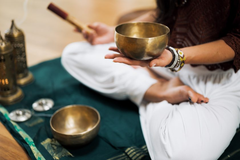 Yoga woman holding Singing Bowl