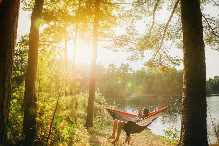 Couple sitting on hammock in outdoors