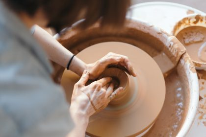 Woman making pottery in ceramics workshop