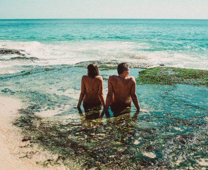 Couple enjoying beach and sea