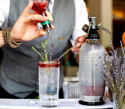 Skylon Bartender making Gin and Tonics