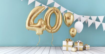 Happy 40th birthday party celebration balloon, bunting and gift box.