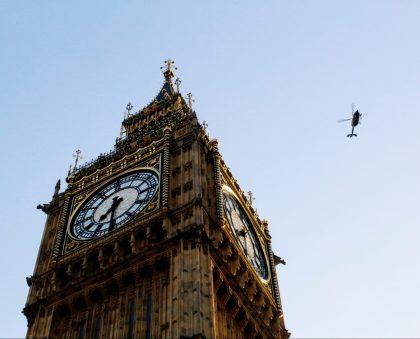 Helicopter flying over Big Ben, London