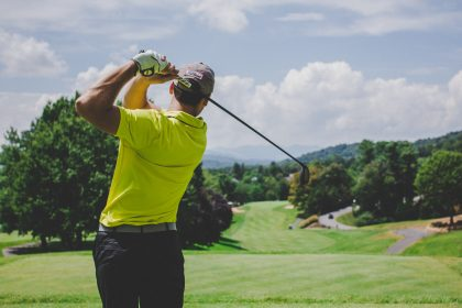 Golfer taking a swing on the golf course